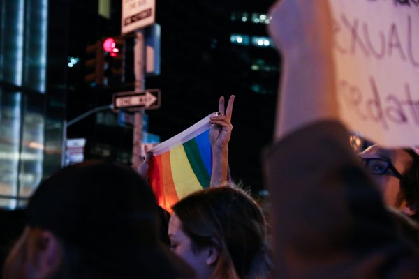 A person holds up a peace sign during protests in New York City