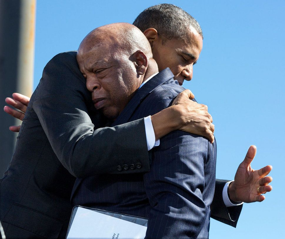 Obama hugs Rep. John Lewis (D-Ga.) after his introduction during the event to commemorate the 50th anniversary of Bloody Sund
