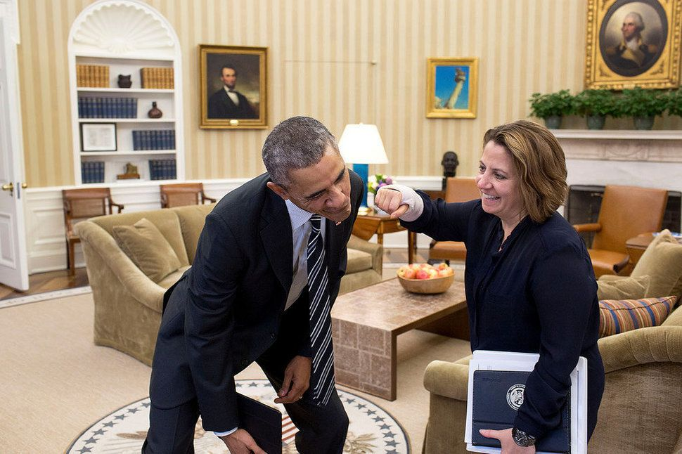 Lisa Monaco, assistant to the president for homeland security and counterterrorism, pretends to punch the president with her