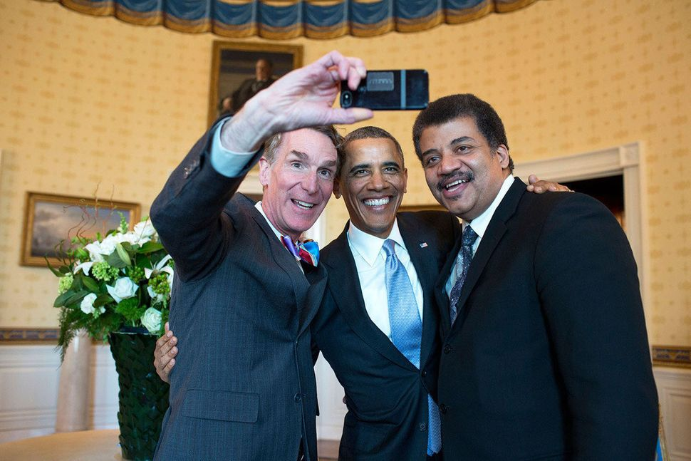 Obama poses for a selfie with Bill Nye (left) and Neil DeGrasse Tyson in the Blue Room prior to the White House Student Film