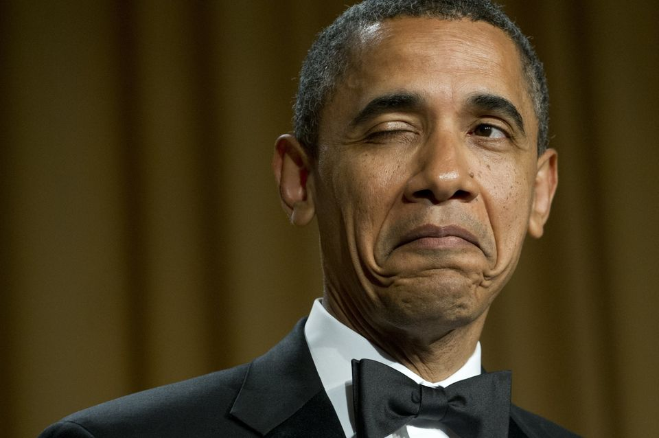 President Obama winks as he tells a joke about his place of birth during the White House Correspondents...