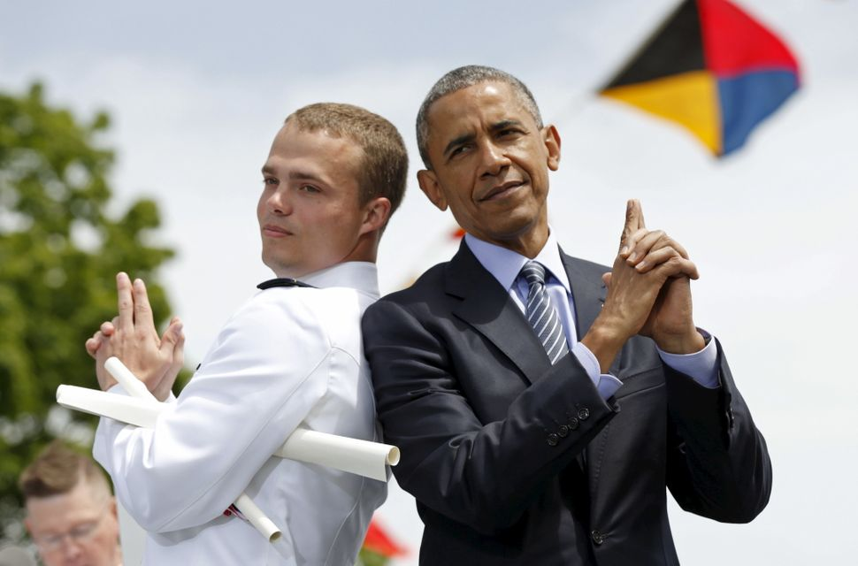 """Graduate Robert McConnel asks Obama to strike a """"James Bond"""" pose during the 134th Commencement Exercises of the United State"""