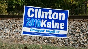 HOT SPRINGS, NC - OCTOBER 20:  A Hillary Clinton and Tim Kaine lawn sign appears across the street from an early polling place located adjacent to the Appalachian Trail as viewed on October 20, 2016 in Hot Springs, North Carolina. Named one of the 'Top 10 Great Places to Retire' by AARP, the area around Asheville is experiencing a major cultural revolution, with the addition of new residents, restaurants, live music, and a vibrant arts community. (Photo by George Rose/Getty Images)