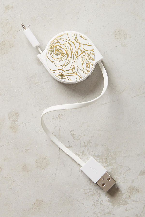 "Triple C Retractable Cord, $28, <a href=""https://www.anthropologie.com/shop/triple-c-retractable-cord?category=phone-cases-te"
