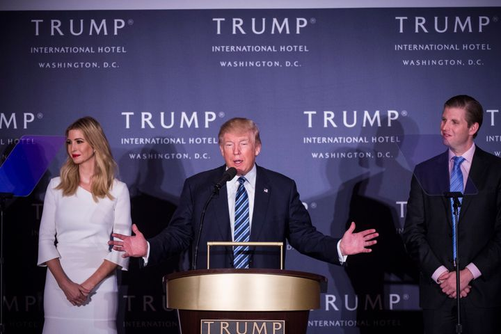 Donald Trump is seen with Ivanka Trump, one of his daughters, and Eric Trump, one of his sons, at the grand opening of the Tr