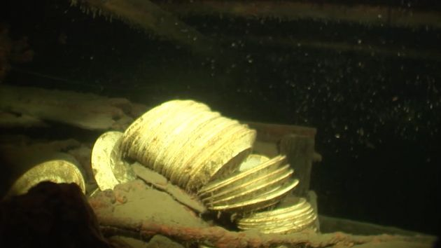 Piles of plates are seen inside of the ship's