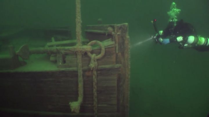A diver approaches the J.S. Seaverns, which sank in 1884.