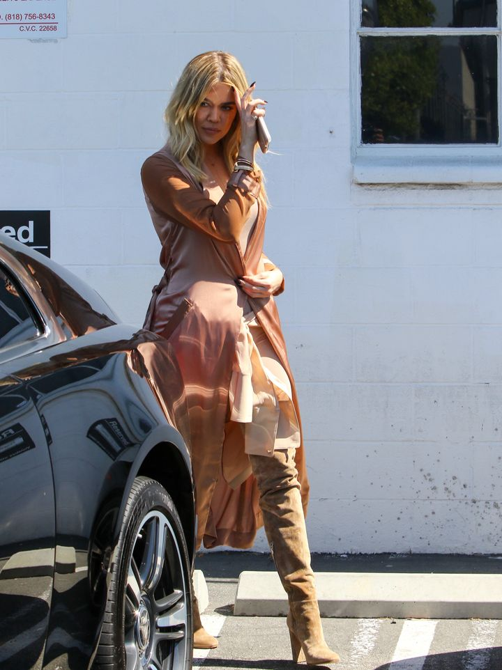 Khloe Kardashian wears her over-the-knee boots.
