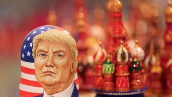 A martyoshka doll showing Donald Trump, U.S. president elect, sits beside painted wooden models of St. Basil's cathedral in a souvenir store in Moscow, Russia, on Wednesday, Nov. 9, 2016. The ruble dropped as Donald Trump won the U.S. presidential race, driving down crude prices on concern his protectionist policies will sap global growth. Photographer: Andrey Rudakov/Bloomberg via Getty Images