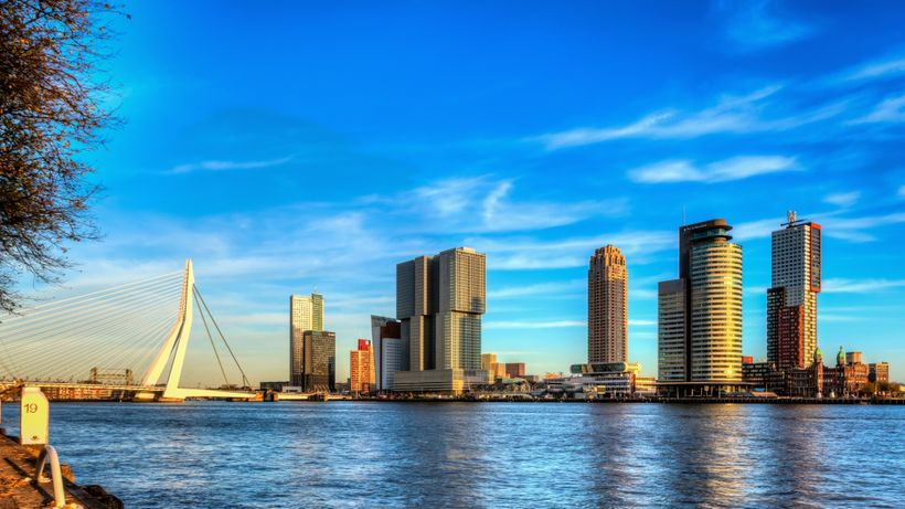 <em>Rotterdam's modern skyline with world famous Erasmus Bridge at left and the massive De Rotterdam building, left of ce