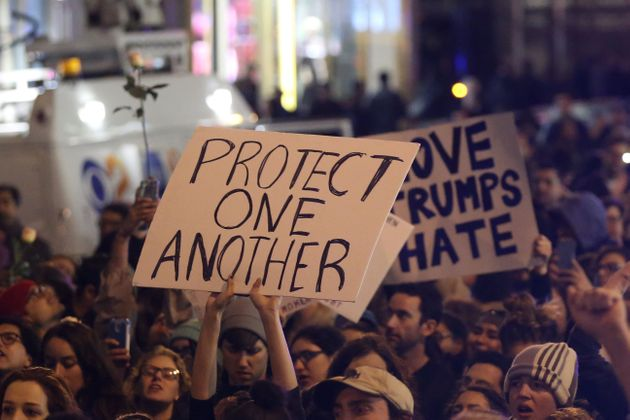 New York: A protestor holds a sign calling for people to 'protect one