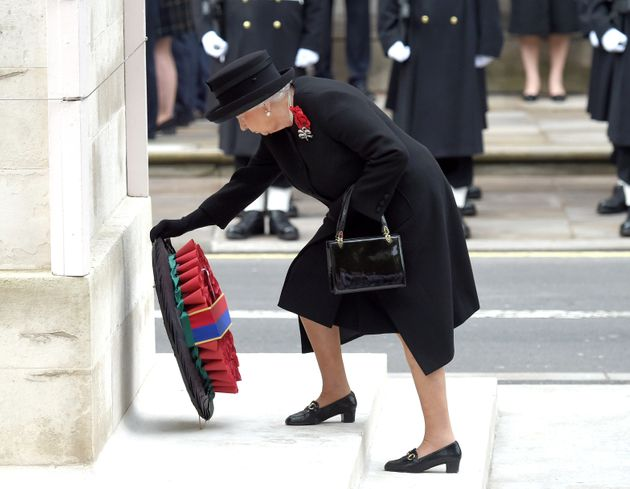 The Queen lays a wreath of poppies at the foot of the Cenotaph in