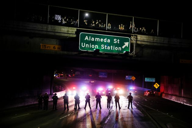 Los Angeles: Police officers stand guard as they slowly clear anti-Trump protesters off the 101