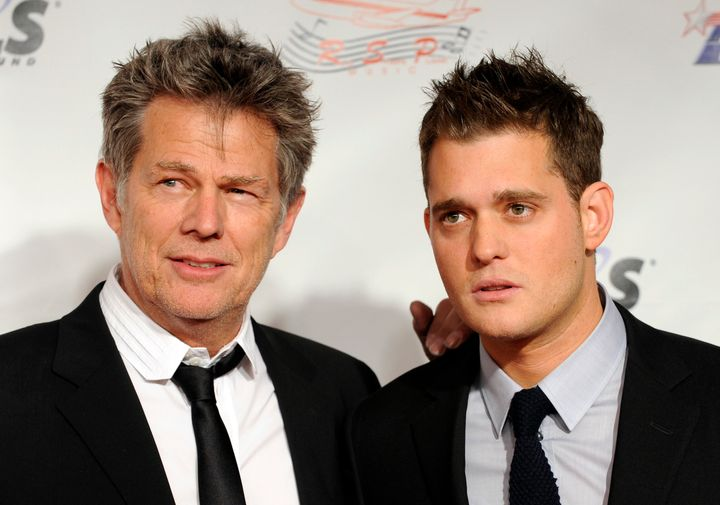 Composer David Foster and singer Michael Bublé pose together in 2009.