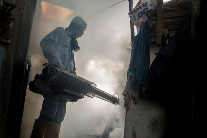 A health worker fogging densely populated areas in Indonesia, on Nov. 7. The fumigation is done to prevent the spread of the