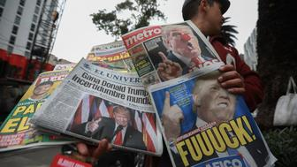 MEXICO CITY, MEXICO - NOVEMBER 09:  Mexican newspapers report on their front pages the victory of the Republican Candidate, Donald Trump during the US elections at Reforma street on November 09, 2016 in Mexico City, Mexico. (Photo by Hector Vivas/LatinContent/Getty Images)