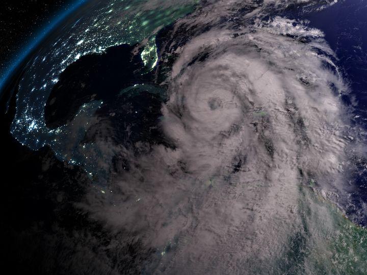 Huge hurricane Matthew at night near Florida. Matthew made landfall in Haiti, Cuba, and the South East US.
