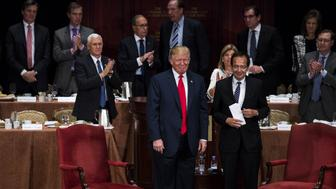 Donald Trump, 2016 Republican presidential nominee, left, smiles after speaking during a fireside chat with John Paulson, president of The Economic Club of New York, at the Economic Club of New York in New York, U.S., on Sept. 15, 2016. Trump is in 'excellent physical health,' according to his long-time doctor, Harold Bornstein, who on Thursday provided a range of details from the candidate's laboratory reports for the first time. Photographer: John Taggart/Bloomberg via Getty Images