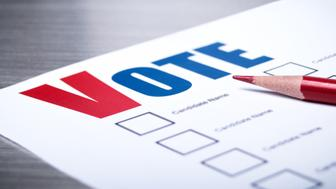 Close-up of a voting ballot with a red pencil