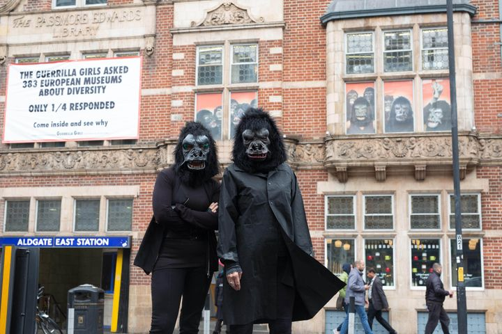 The Guerrilla Girls, a group of anonymous feminist activists founde din 1985, unveil a banner on a building in London to