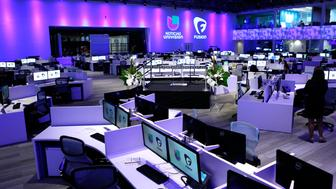The large newsroom for Univision and Fusion networks is shown during opening ceremonies in Doral, Florida August 28, 2013.  Univision Networks President Cesar Conde said the newsroom is believed to be the largest state-of-the-art news facility in the country. Spanish language behemoth Univision is ramping up its new English cable news network Fusion aimed at younger viewers, hiring hundreds of staffers and building a flashy newsroom as it prepares to enter the crowded field of cable news channels.    REUTERS/Joe Skipper  (UNITED STATES - Tags: MEDIA BUSINESS)