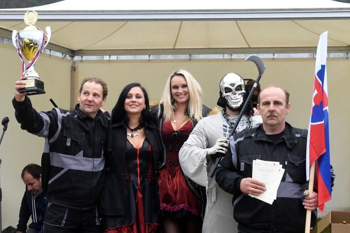Winners, brothers Ladislav (R) and Csaba (L) Skladan from Slovakia, pose for a photo after a grave digging championship in Tr