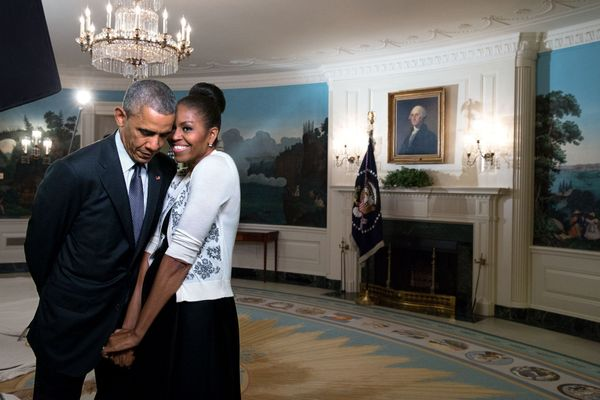 The first lady snuggles against the president during a videotaping for the 2015 World Expo in the Diplomatic Reception R