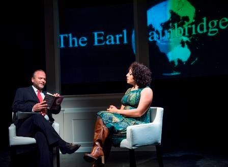 TV host Earl Bainbridge (Dale Albright) interviews Arab-American novelist Noor Badrawi (Denmo Ibrahim) in a scene from  <stro