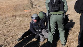 A protester is arrested next to the pipeline route during a protest against the Dakota Access pipeline near the Standing Rock Indian Reservation in St. Anthony, North Dakota, U.S. November 11, 2016. REUTERS/Stephanie Keith