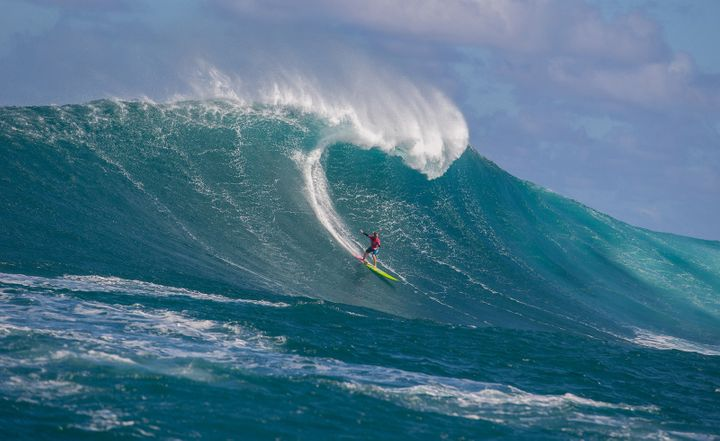 Paige Alms, pictured above, won the World Surf League's first-ever big wave surf competition for women.