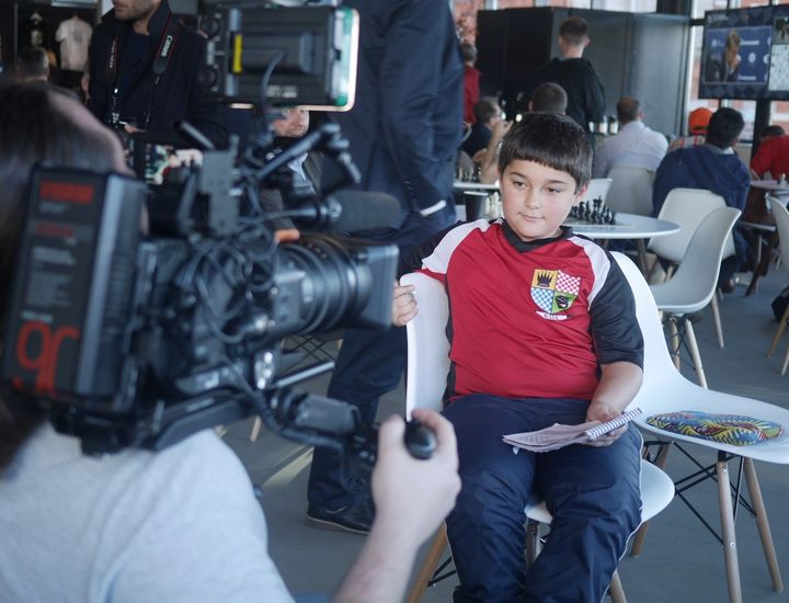 A young chess fan is interviewed by Russian media