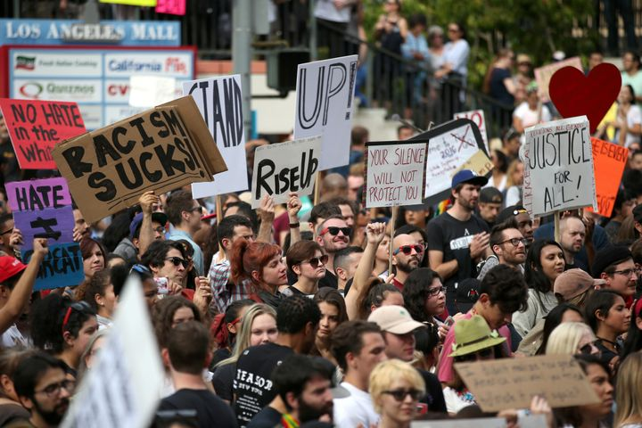 People gather outside a federal building during a march and rally against the election of Republican Donald Trump as Presiden