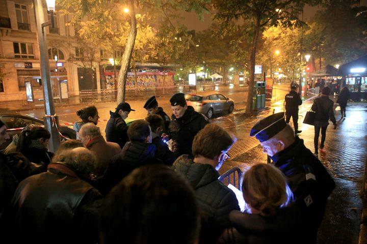 Policemen search concert goers outside Le Bataclan Concert Hall on Nov.12, 2016, in Paris.