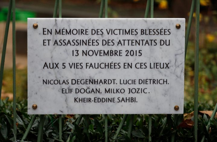 A commemorative plaque unveiled by Hollande and Hidalgo is seen next to the A La Bonne Biere cafe in Paris.