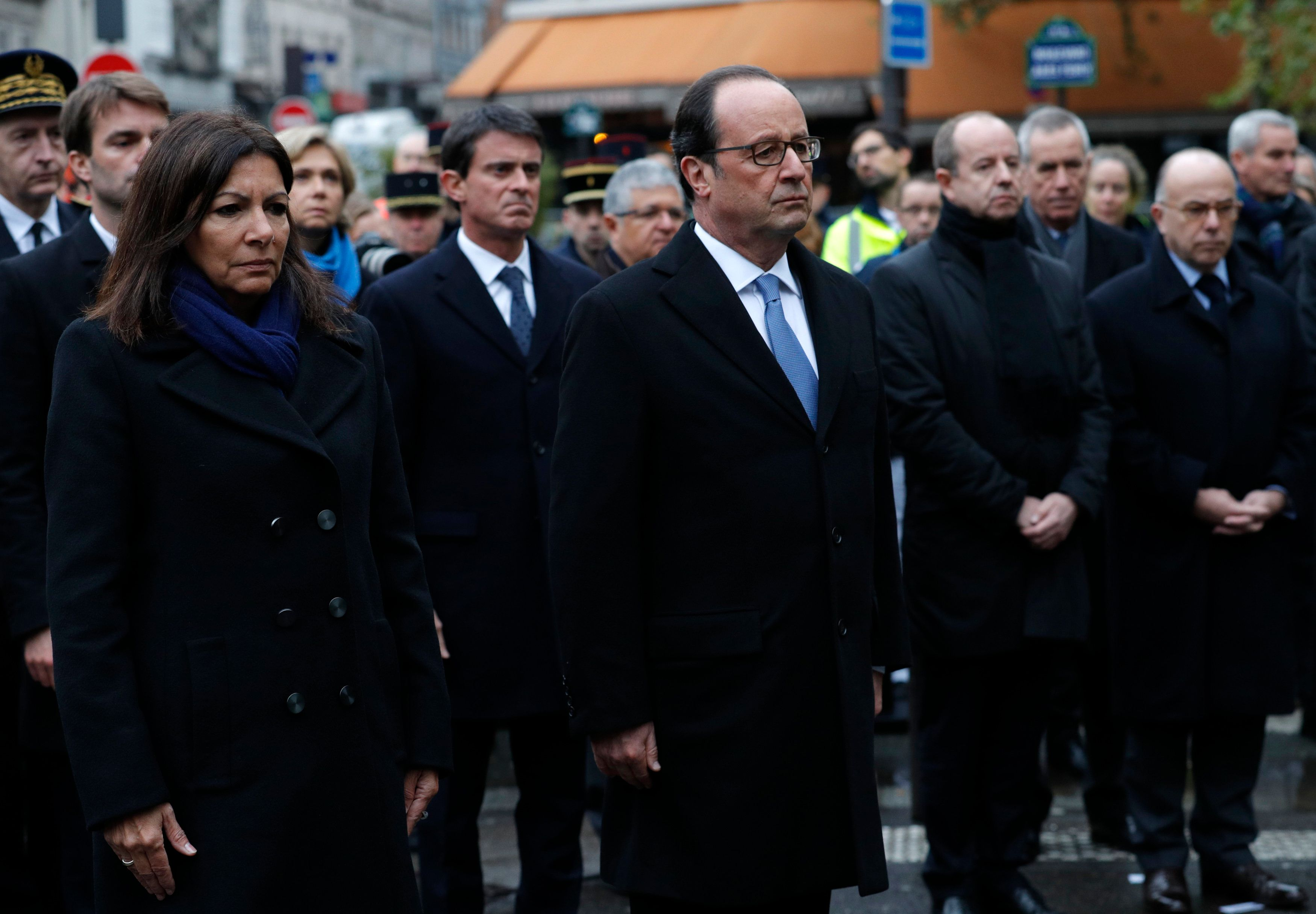 French President Francois Hollande and Paris Mayor Anne Hidalgo unveil a commemorative plaque next to...