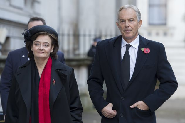 Former Prime Minister Tony Blair and Cherie Blair walk through Downing Street on their way to the annual...