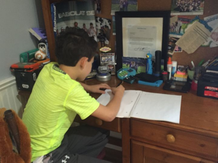 <p>My son writing down his questions for me to take to the Food Allergy Bloggers Conference (FABlogcon) in Denver, Colorado.</p>