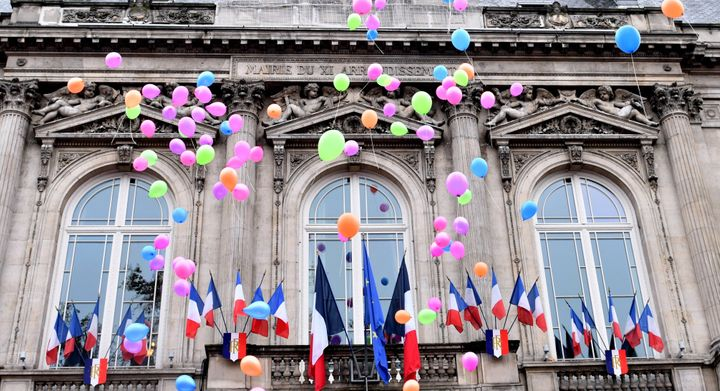 French people release balloons during the first anniversary of the Paris terror attacks in front of the city hall of the 11th arrondissement.