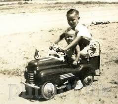 Vintage photo of a child in his toy car