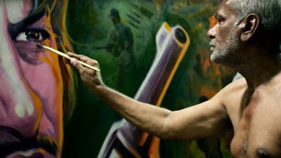 Sheik Rehman painting a billboard for a movie in a scene from <strong><em>Original Copy</em></strong>