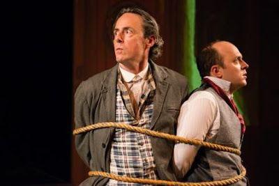 Michael Monagle (Sherlock Holmes) and Dan Seda (Watson) in a tense scene from <em><strong>Baker Street</strong></em>