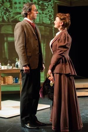 Michael Monagle (Sherlock Holmes) and Abby Haug (Irene Adler) in a scene from <strong><em>Baker Street</em></strong>