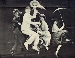 """Tommy Steele leads the ensemble in """"If The Rain's Got to Fall"""" in 1965's <strong><em>Half A Sixpence</em></strong> (music and"""