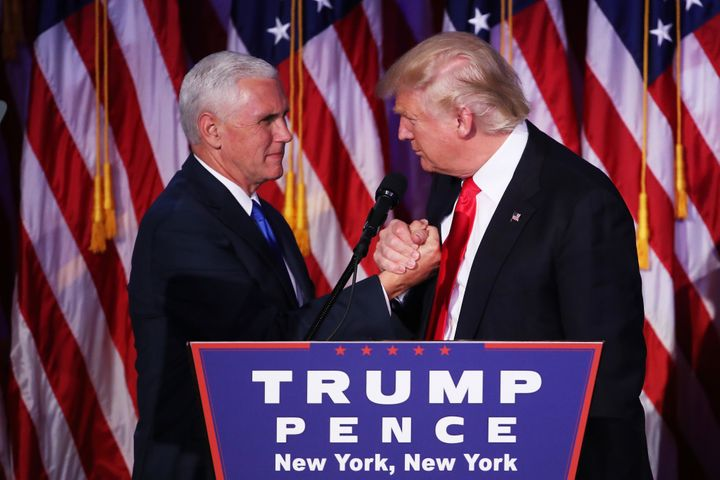 Vice president-elect Mike Pence and Republican president-elect Donald Trump shake hands during his election night event in Ne