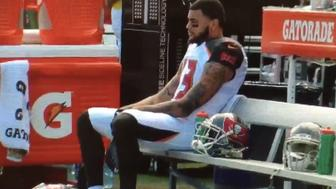 Mike Evans sits during the national anthem in protest of PresidentElect Donald Trump