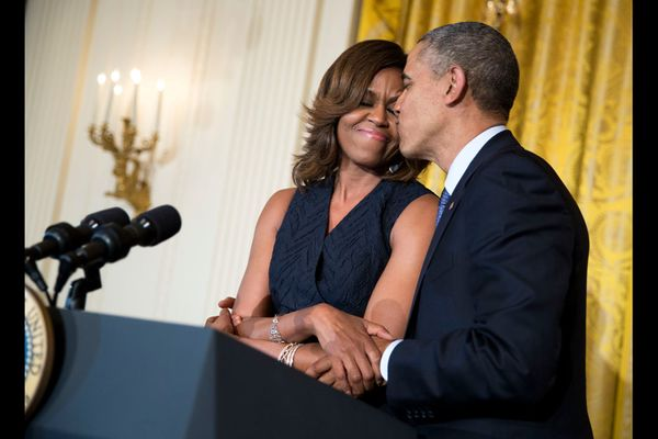 Michelle and Barack Obama at an Affordable Care Act reception in the East Room of the White House on May 1, 2014.