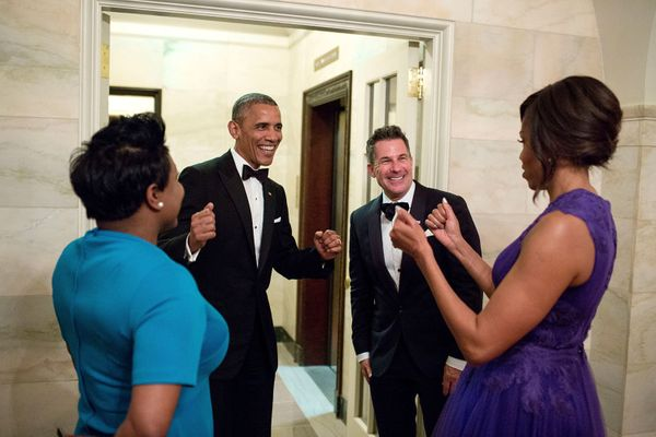 President Barack Obama and first lady Michelle Obama celebrate with outgoing social secretary Jeremy Bernard and incomin