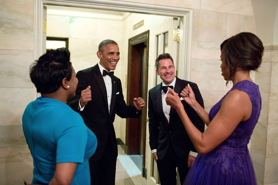 President Barack Obama and first ladyMichelle Obama celebrate with outgoing social secretary Jeremy Bernard and incomin