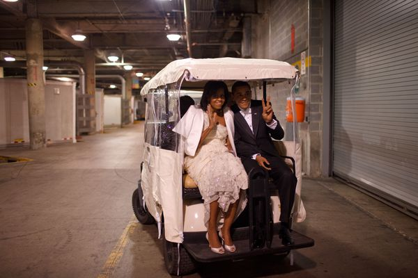 President Barack Obama and first lady Michelle Obama ride on a golf cart at an inaugural ball on Jan. 20, 2009