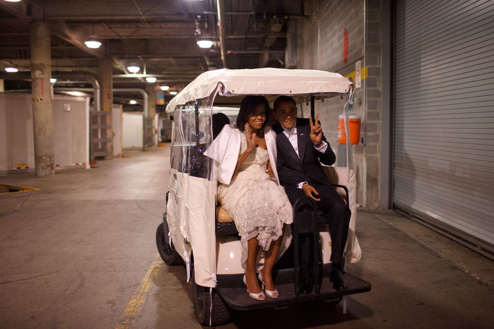 President Barack Obama and first ladyMichelle Obama ride on a golf cart at aninaugural ballon Jan. 20, 2009